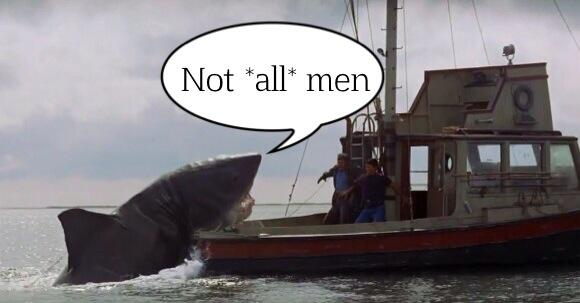 "A scene from the movie Jaws. A giant shark rest on the back of a small boat, half in and half out of the water. In a speech balloon, he says ""Not all men!"""